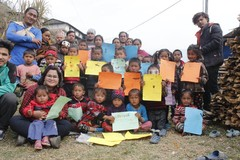 Group photo of primary school students in Nepal.