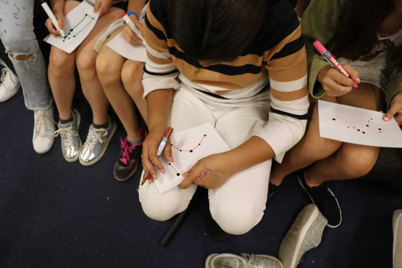 Children are drawing a constellation during a try out activity in Switzerland