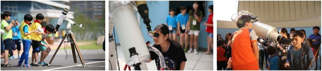 Children look through telescopes