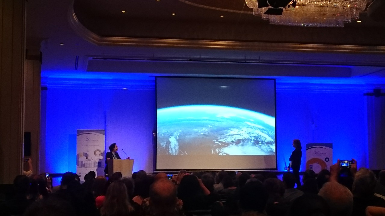 Mahbobah Ahmadi gives a presentation about the projects of the Astronomy & Society Group of Leiden University during the plenary session
